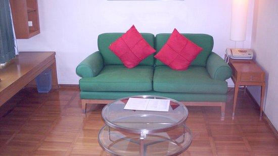 AT EASE Saladaeng by Aetas: wood floors, sofa in living room