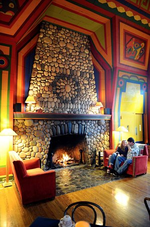 Naniboujou Historic Lodge Restaurant: Get cozy by our fireplace, the largest stone fireplace in the state of Minnesota.