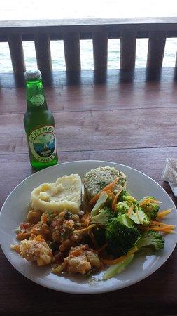 بونتا جوردا, بليز: Enjoying lunch over the water with a refreshing Belizean Lighthouse beer!