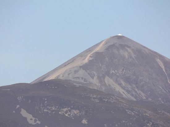 Croagh Patrick: The long shoulder of the mountain - you need a stick sold at the corner booth at the base