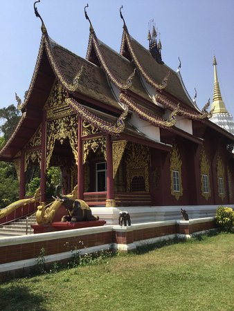 Fang City, Thailand: There are two Temples on the grounds, with this one being the latest. Beautiful wood picture car
