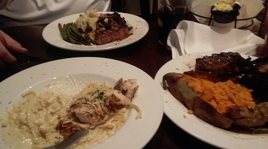 Crawdaddy's West Side Grill : Top is Ribeye w/ Garlic Mashed Potatoes, bottom right Rack of Lamb with Sweet Potatoe