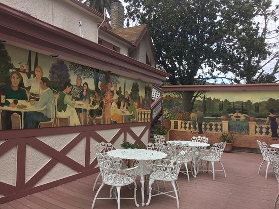Part of the outdoor patio with murals Picture of Rose Garden