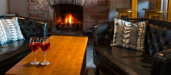 Earlston, UK: Enjoy a drink by our large open fire in the bar during the colder months