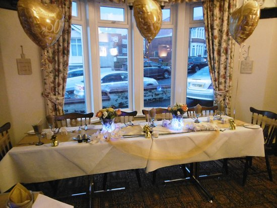 The Moorings Hotel: Dinning room set for anniversary.