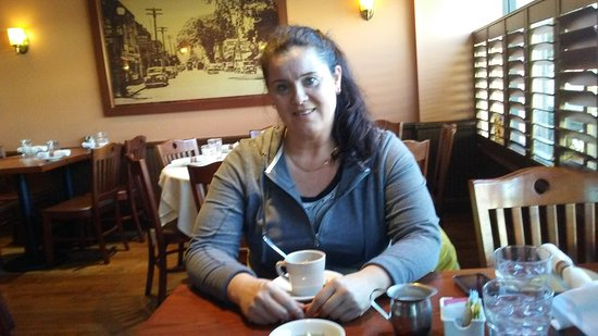 Sayville, NY: My wife relaxing with a cup of coffee
