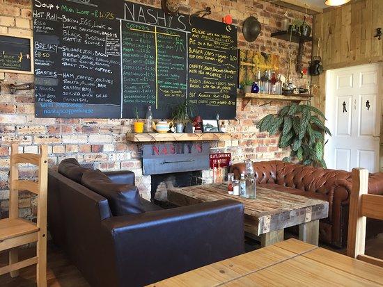 Cardrona, UK: Menu and fireside sofas at Nashys