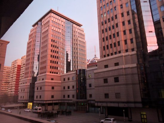 Holiday Inn Central Plaza: Sunrise reflecting off of neighboring buildings.