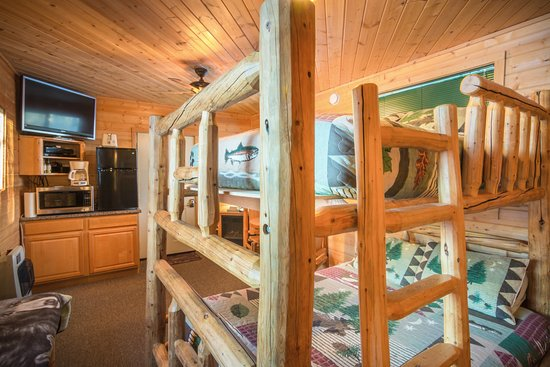 Oversized Custom Log Bunk Bed Features A Queen Bed On Bottom And