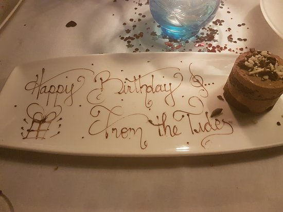 This lovely chocolate cake came with singing and well wishes for a