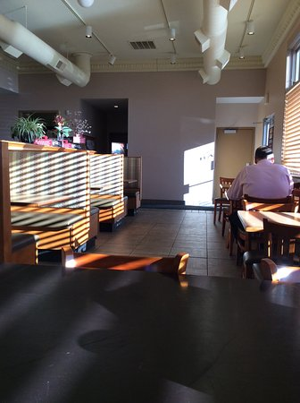 Clive, IA: Booths and tables with 4 chairs