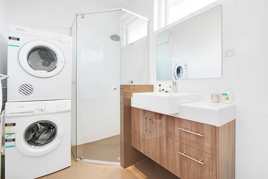 modern bathroom with washing machine dryer picture of. Black Bedroom Furniture Sets. Home Design Ideas