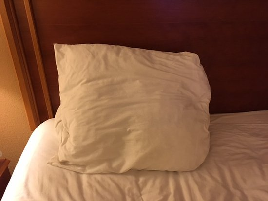 Florissant, MO: Tiny pillow on king size bed.