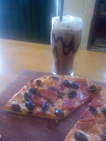 Limuru, Kenya: we had a pepperoni pizza topped with black olives and a glass of iced mocca .