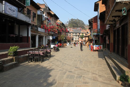 The Old Inn: Main street of Bandipur, Old Inn on left, Himalayas behind