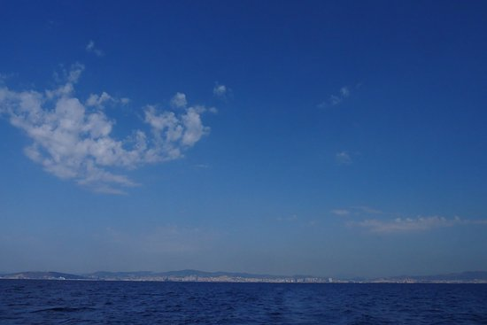 Sailing Barcelona: morning clouds