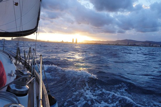 Sailing Barcelona: windy sunset in front of Barcelona