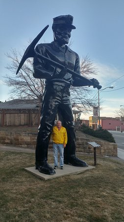 Helper, UT: Big John is big (man is 6')