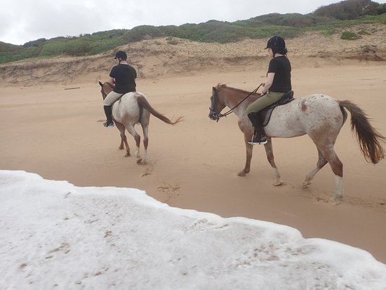 Zitundo, Mozambique: Horse riding on the beach during a rare cloudy day at White Pearl