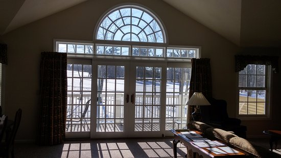 Bethel, ME: Sunny windows in living room area in one-bedroom townhouse