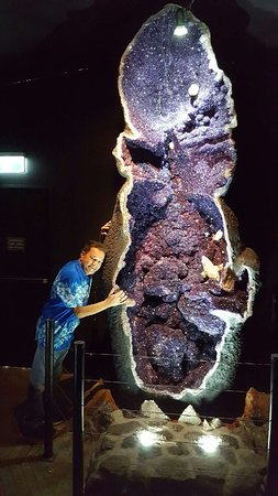 The Crystal Caves: Standing next to the huge amethyst crystal in the Crystal Cave Museum... very aweinspiring