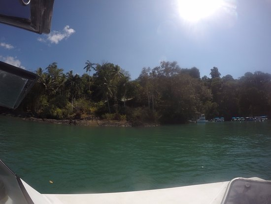 Aguila de Osa Inn: the view from the boat, dining room in the middle of the picture