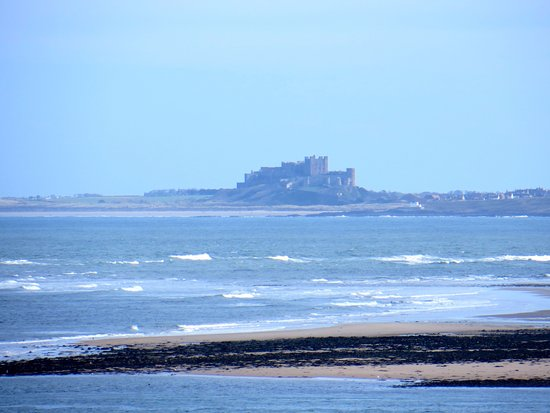 Holy Island, UK: View of Bamburgh Castle from Lindisfarne (looking southwards)