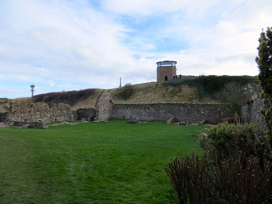 Holy Island, UK: View of the lookout on the hill from the Priory grounds