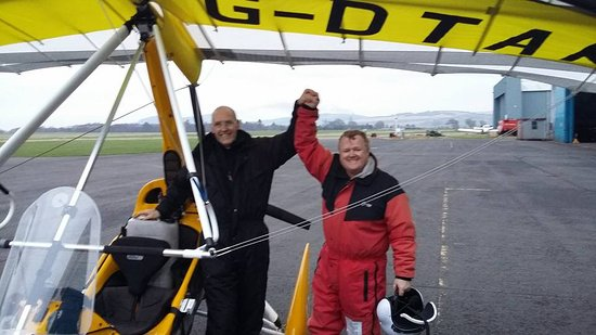 Scone, UK: Great achievement.  Joe flying high above Perth.  Seen here on the right, with his instructor Bo