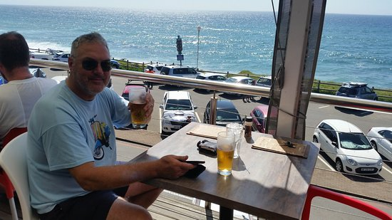 Caffe Java: A patron enjoying a beer