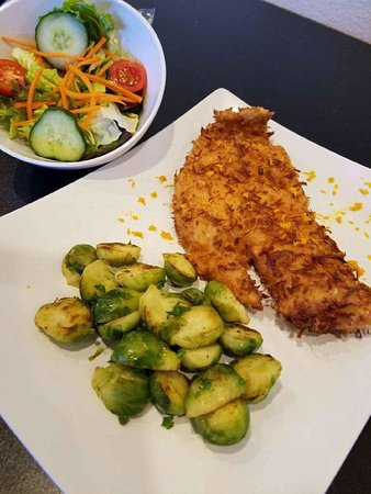 Lecanto, FL: Our Coconut Flounder comes served with brussels sprouts and a side salad.