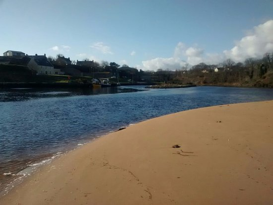 View of River Brora and harbour from sandy beach