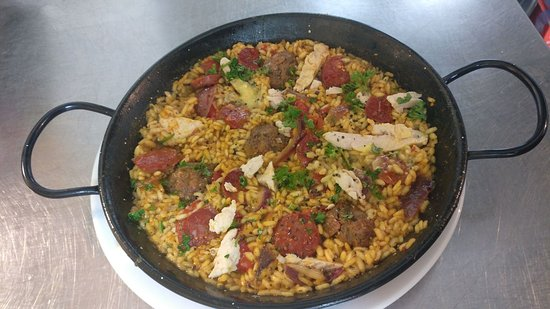 Cheadle, UK: One of our new dishes our neat paella for 2 ummm yummy