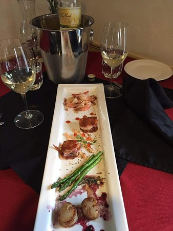 Meridian, ID: Tapas Tuesday is a great way to sample some unique foods. Here is bacon-wrapped shrimp, seared s