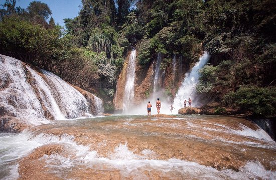 Lashio, Myanmar: Levitating below the surge at Dark Horse Falls