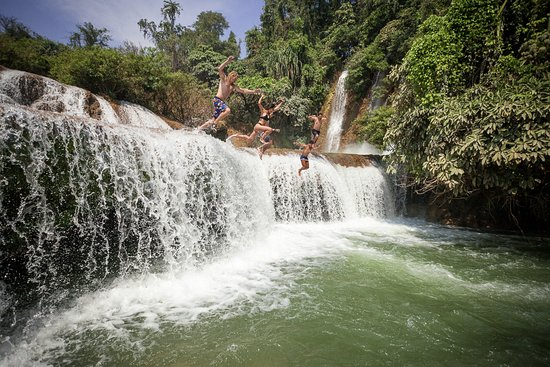 Lashio, Myanmar: Group jumping the falls at Dark Horse Falls
