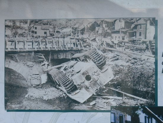 Houffalize, เบลเยียม: Tank overturned in river following the battle