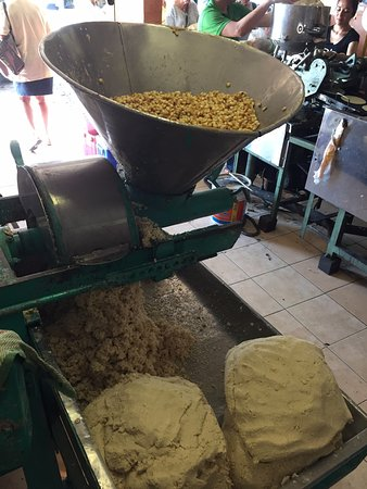 Cookin' Vallarta: The corn being ground into Masa