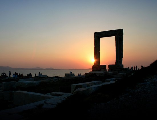 Remains of temple of Apollo - known as Portara monument - in beautiful sunset on Naxos, Greece