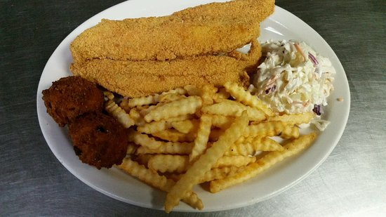 Ore City, TX: Seasoned Fried Fish Platter with french fries, homemade coleslaw and hushpuppies.