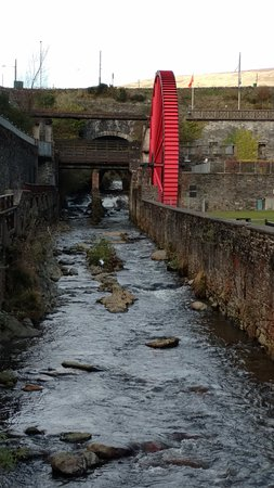 Smaller wheel facing upstream (towards the Laxey Wheel.) Woolen shops are in the opposite direct