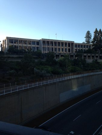 Parliament House: Building frontage from top of St Georges Ave and across freeway