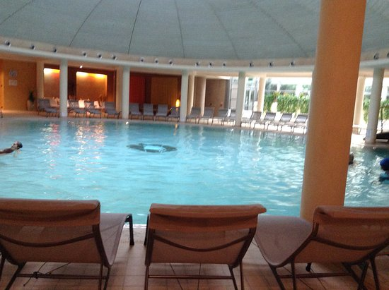Hotel Caesius Thermae & Spa Resort : Large indoor heated pool with large whirlpool are to right of photo