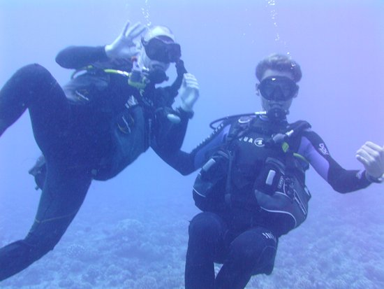 TOPDIVE Bora Bora: my husband with Alex, our dive master. He rocked!!!!