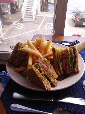Tugboat Inn Restaurant: Hubby liked his BLT Club and Fries!