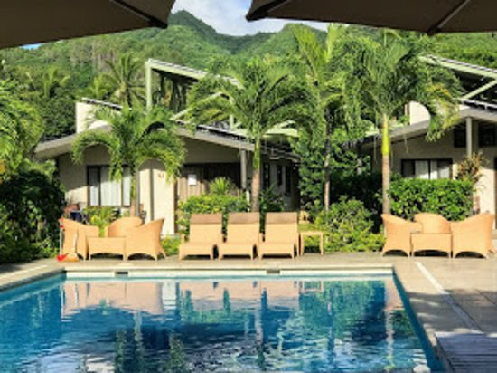 Muri Beach Resort Pool With Umbrellas And New Style Outdoor Furniture