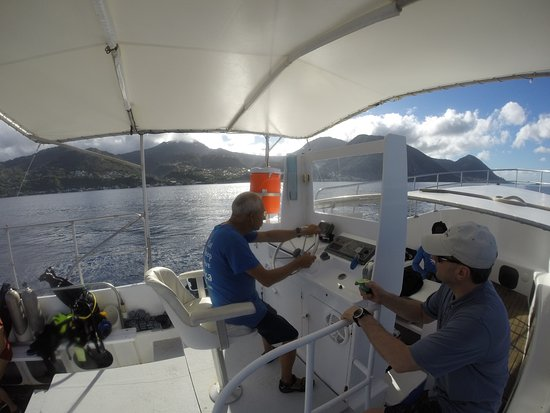 Roseau, Dominica: captain Harry at the helm