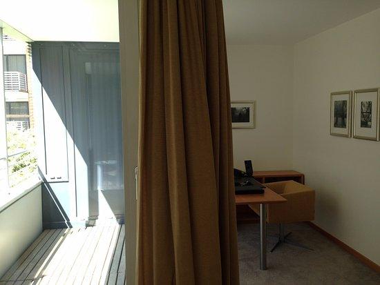 The Mandala Hotel: study and balcony