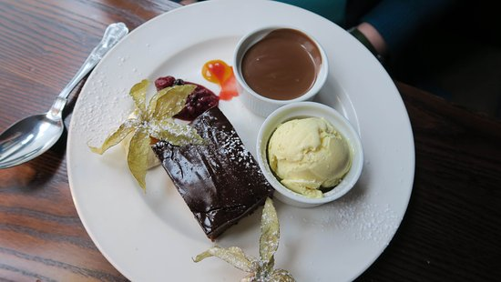 Dalkey, Ireland: Chocolate Brownie with Sauce and extra Ice Cream