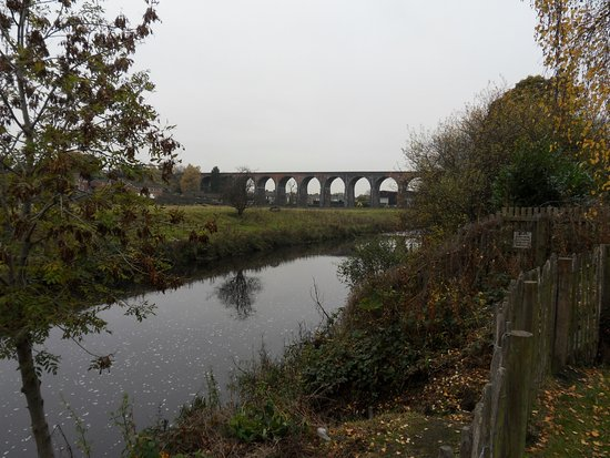 "The River Calder and Whalley ""Arches"" from the abbey gardens"